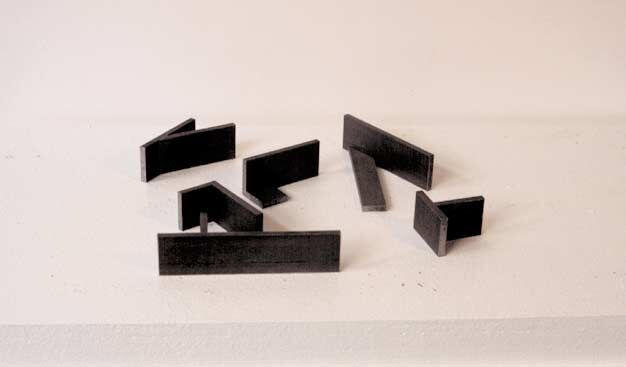 Environmental Sculpture I, 1982, steel, 3.8 x 30.5 x 30.5 cm. Collection of the artist