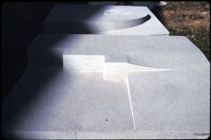 Cristalli in formazione (seven elements), 1998–2002, pietra serena, 100 x 100 x 100 cm (each). Collection of the Town of Panicale, Italy, 2002