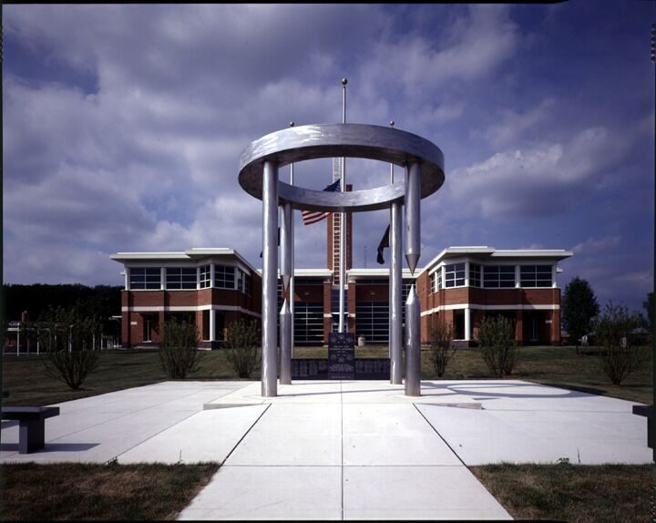 Ara Pacis, or Ara Pace—Place of Peace, 1995, stainless steel, limestone & concrete, 457.2 x 1219.2 x 1219.2 cm.  Collection of the Village of Orland Park, Village Hall Veterans Memorial, Orland Park, IL, USA, 1995.