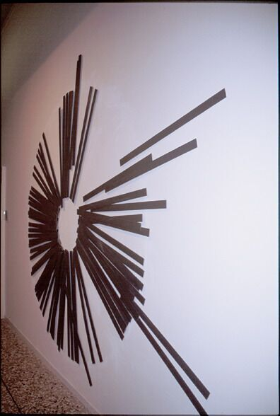 Cerchio in formazione (relief), 1985–2003, stainless steel, 220 x 300 x 61 cm. Collection of the artist.