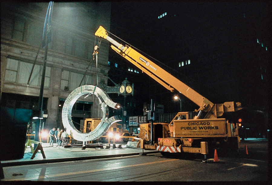 City workers set the sculpture