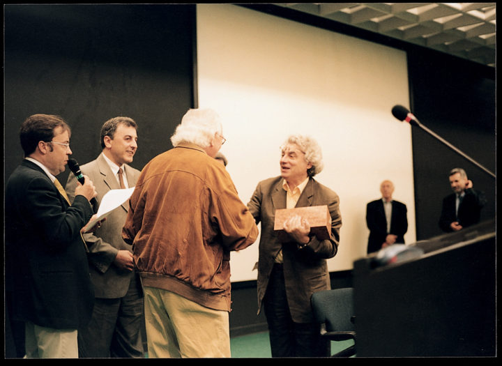 Ferrari presents Meeting Elements XIV to Mario Botta, architect, on behalf of the City of Verona. Verona, Italy, 2004. Personal photograph.
