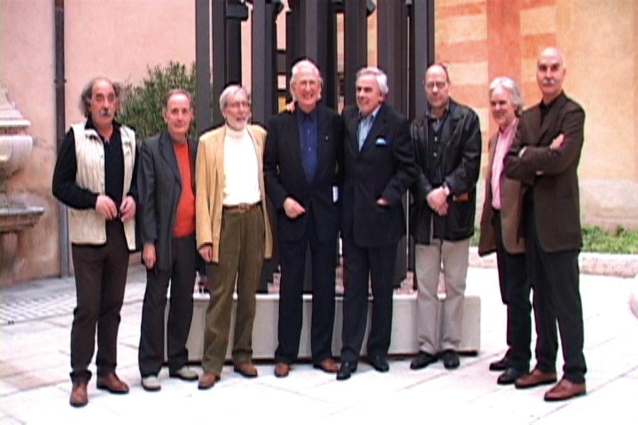 Ferrari with artists Ricardo Cassini, Silvano Girardello, Giorgio Olivieri, Giorgio Cortenova, Mario Colognese, Novello Finotti, and Igino Legnaghi
